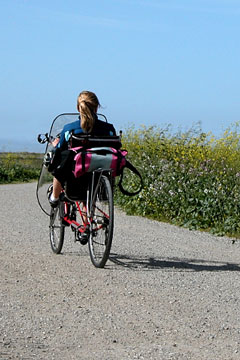 girl riding a recumbent bicycle